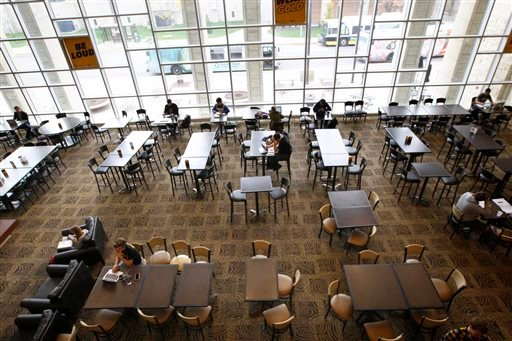 The University of Missouri's Student Center remains largely unpopulated Wednesday morning, Nov. 11, 2015, in Columbia, Mo. University of Missouri police said Wednesday they have arrested a suspect accused of making online threats against black students an