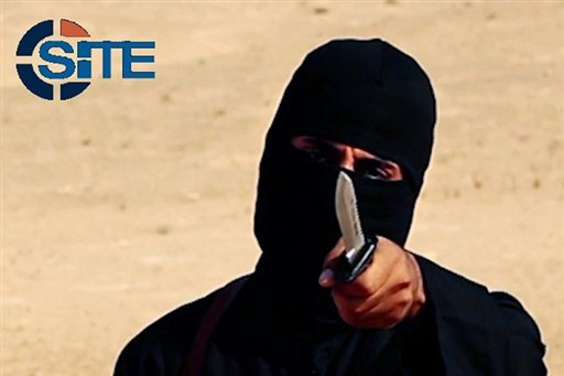 "This image made from militant video, shows Mohammed Emwazi , known as ""Jihadi John,"" holding a knife."