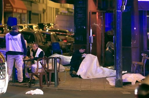 Victims lay on the pavement outside a Paris restaurant, Friday, Nov. 13, 2015.