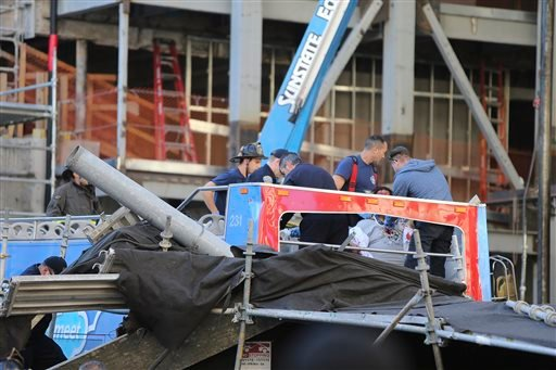 Fire and police assist injured people on an open-air tour bus after it crashed into a construction site near Union Square Friday, Nov. 13, 2015 in San Francisco.