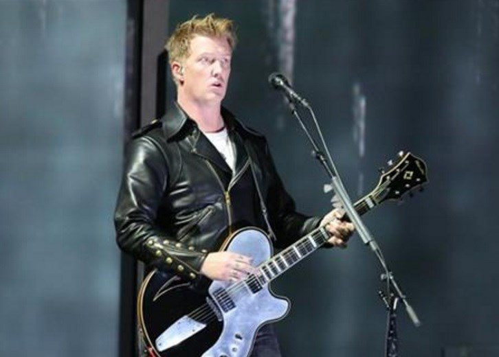 Joshua Homme, of Queens of the Stone Age, performs at the 56th annual Grammy Awards in Los Angeles. Homme was scheduled to perform, Friday, Nov. 13, 2015, with his band Eagles of Death Metal at the Bataclan venue in Paris where patrons were taken hostage.
