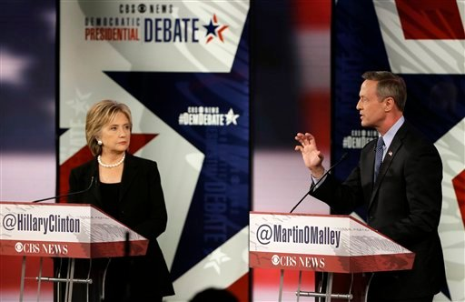 Martin O'Malley, right, speaks as Hillary Rodham Clinton watches during a Democratic presidential primary debate, Saturday, Nov. 14, 2015, in Des Moines, Iowa. (AP Photo/Charlie Neibergall)
