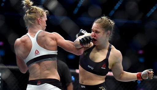 Holly Holm, left, and Ronda Rousey exchange their punches during their UFC 193 bantamweight title fight in Melbourne, Australia, Sunday, Nov. 15, 2015. Holm pulled off a stunning upset victory over Rousey in the fight, knocking out the women's bantamweigh