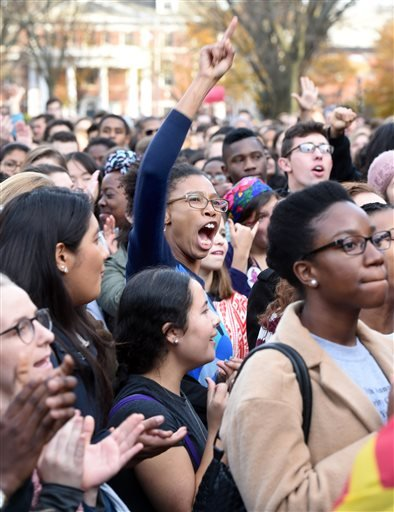In this Nov. 9, 2015, file photo, Yale University students and faculty rally to demand that Yale University become more inclusive to all students on Cross Campus in New Haven, Conn. At schools including Michigan and Yale, students say the protests that le