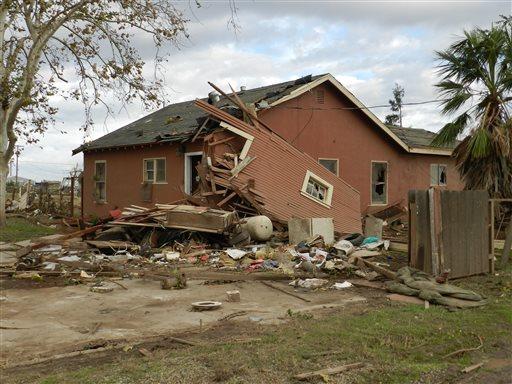 Debris lies on the ground where Sabina and Zane Woodard's garage once stood after reports of a rare tornado in Denair, Calif., Sunday, Nov. 15, 2015. (Deke Farrow/The Modesto Bee via AP)