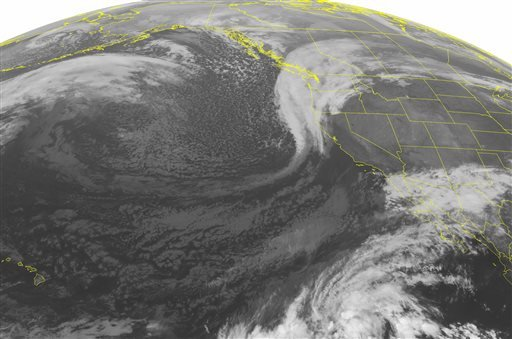 This NOAA satellite image taken Sunday, Nov. 15, 2015, at 01:00 AM EDT shows a storm developing over the Pacific Northwest that is loaded with moisture.
