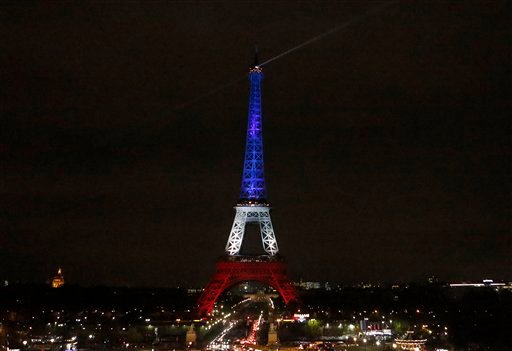 The Eiffel Tower is illuminated in the French national colors red, white and blue in honor of the victims of the terror attacks last Friday in Paris, Monday, Nov. 16, 2015. France is urging its European partners to move swiftly to boost intelligence shari