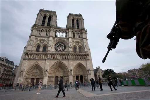 A soldier patrols at Notre Dame cathedral in Paris, Monday, Nov. 16, 2015. France is urging its European partners to move swiftly to boost intelligence sharing, fight arms trafficking and terror financing, and strengthen border security in the wake of the