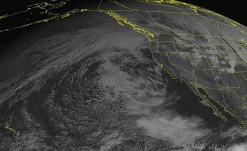 This NOAA satellite image taken Wednesday, Nov. 18, 2015 at 1:00 PM EST shows clouds moving into the Pacific Northwest, with some rain showers.  AP
