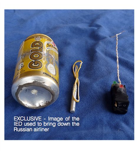 This undated image made available in the Islamic State's English-language magazine Dabiq, Wednesday, Nov. 18, 2015, claims to show the bomb that was used to blow up a Metrojet passenger plane bound for St. Petersburg, Russia, that crashed in Hassana, nort