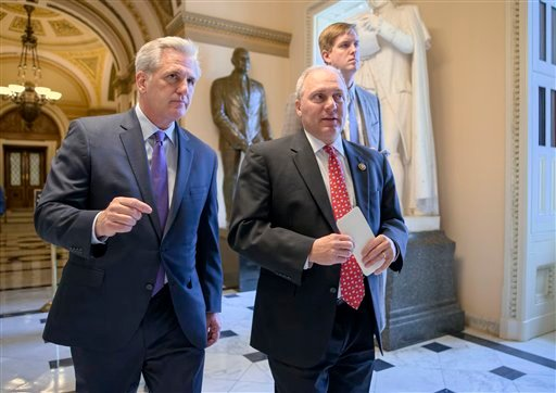 House Majority Leader Kevin McCarthy of Calif., left, and House Majority Whip Steve Scalise of La., stride from the House chamber on Capitol Hill in Washington, Wednesday, Nov. 18, 2015. (AP Photo/J. Scott Applewhite)