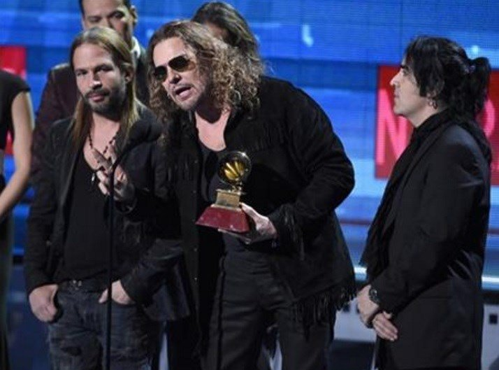 """Fher Olvera, of Mana, accepts the award for pop rock album for """"Cama Incendiada"""" at the 16th annual Latin Grammy Awards at the MGM Grand Garden Arena on Thursday, Nov. 19, 2015, in Las Vegas. (Photo by Chris Pizzello]/Invision/AP)"""