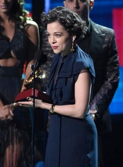 """Natalia Lafourcade accepts the award for record of the year for """"Hasta La Raiz"""" at the 16th annual Latin Grammy Awards at the MGM Grand Garden Arena on Thursday, Nov. 19, 2015, in Las Vegas. (Photo by Chris Pizzello]/Invision/AP)"""