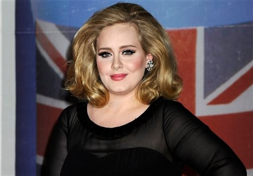 """In this Feb. 21, 2012 file photo, performer Adele arrives for the Brit Awards 2012 at the O2 Arena in London. The singer's hotly anticipated new album, """"25,"""" is out Friday, Nov. 20, 2015."""