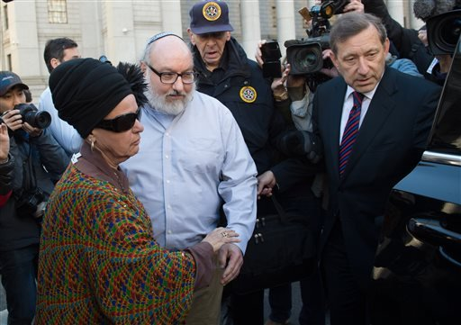 Convicted spy Jonathan Pollard and his wife, Esther leave the federal courthouse in New York Friday, Nov. 20, 2015.