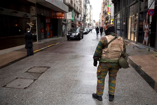 A Belgian Army soldier patrols a main shopping street in Brussels on Saturday, Nov. 21, 2015.