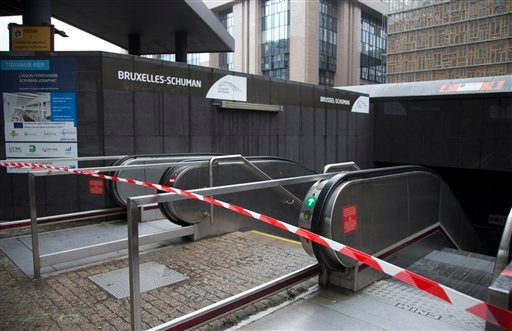 Police tape blocks the entrance of a metro station in Brussels on Saturday, Nov. 21, 2015.