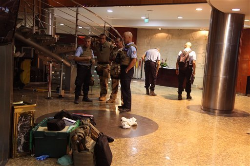 French troops, rear, inside the Radisson Blu hotel after an attack by gunmen on the hotel in Bamako, Mali, Friday, Nov. 20, 2015.