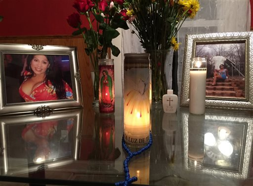 This photo shows an altar made by the friends of Tamara Dominguez during a memorial service for her at her home. (Randall Jenson/Kansas City Anti-Violence Project via AP)