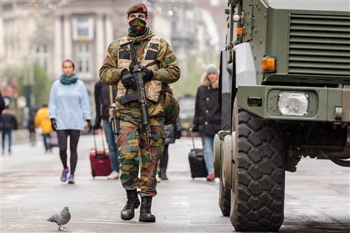 A Belgian Army soldier patrols on a main boulevard in Brussels, Sunday, Nov. 22, 2015. Western leaders stepped up the rhetoric against the Islamic State group on Sunday as residents of the Belgian capital awoke to largely empty streets and the city entere