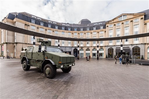 A Belgian Army vehicle is parked on the almost deserted square in front of the main train station in the center of Brussels on Sunday, Nov. 22, 2015. Western leaders stepped up the rhetoric against the Islamic State group on Sunday as residents of the Bel