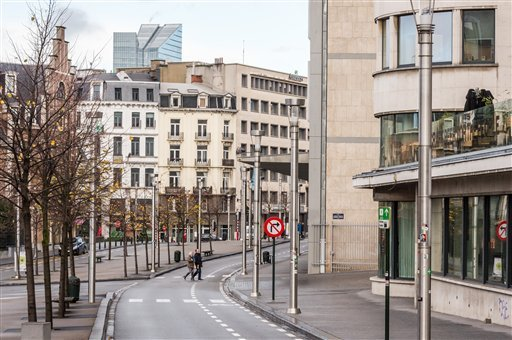 Two people cross a deserted street near the main train station in the center of Brussels on Sunday, Nov. 22, 2015. Western leaders stepped up the rhetoric against the Islamic State group on Sunday as residents of the Belgian capital awoke to largely empty
