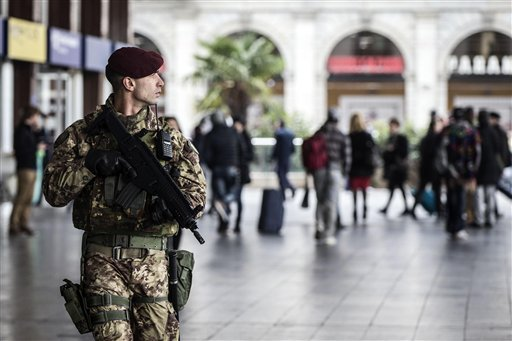 A soldier patrols outside Rome's Termini main train station Nov. 23, 2015. Italy and the Vatican beefed up security with some 700 soldiers deployed following the Paris attacks and before Pope Francis' big Jubilee Year. (Angelo Carconi/ANSA via AP)