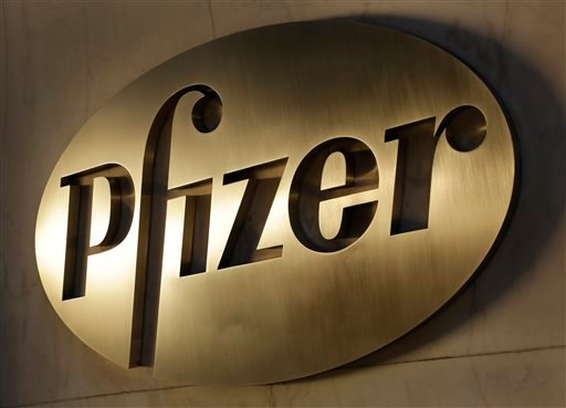 The Pfizer logo is displayed at world headquarters, Monday, Nov. 23, 2015, in New York. Pfizer and Allergan will join in a $160 billion deal to create the world's largest drugmaker. (AP Photo/Mark Lennihan)