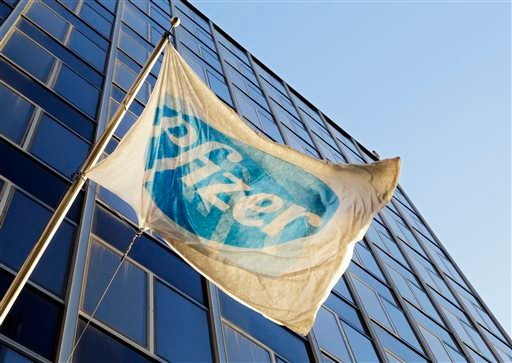 The Pfizer flag flies in front of world headquarters, Monday, Nov. 23, 2015, in New York. Pfizer and Allergan will join in a $160 billion deal to create the world's largest drugmaker. (AP Photo/Mark Lennihan)