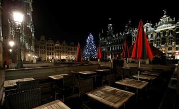 (AP Photo/Alastair Grant). Empty tables are seen at a restaurant on the Grand Place in Brussels, Monday, Nov. 23, 2015.