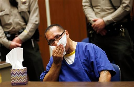 Luis Vargas, who has been in prison for 16 years, reacts in court as he is exonerated Monday, Nov. 23, 2015, in Los Angeles. A judge exonerated Vargas, convicted of three rapes, after DNA evidence linked the crimes to a serial rapist wanted for assaults d