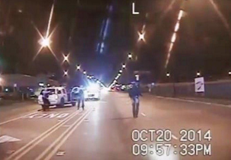 In this Oct. 20, 2014 frame from dash-cam video provided by the Chicago Police Department, Laquan McDonald, right, walks down the street moments before being shot by officer Jason Van Dyke in Chicago. AP