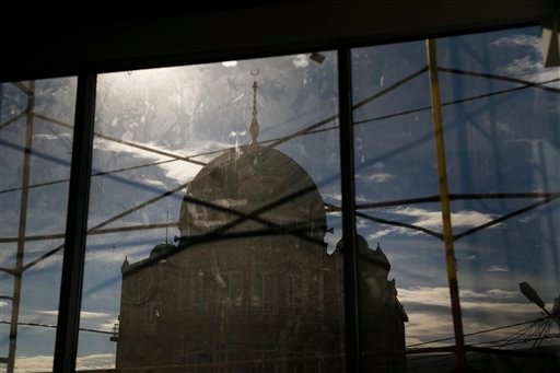 In this photo taken Friday, Nov. 13, 2015, the Salafi mosque on Kotrova street, in Dagestan's regional capital Makhachkala, Russia is outlined against the sky. An epidemic of recruitment for the Islamic State group has swept through the predominantly Musl