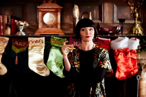 """This photo provided by Acorn TV shows, Essie Davis as Phryne Fisher in the episode """"Murder Under the Mistletoe"""" of series 2 """"Miss Fisher's Murder Mysteries,"""" on Acorn TV. A monthly subscription to a streaming site is the gift that keeps on giving. (Acorn"""