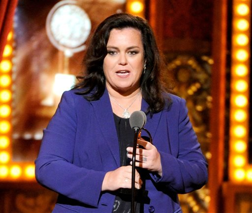 In this June 8, 2014 file photo, Rosie O'Donnell accepts the Isabelle Stevenson Award on stage at the 68th annual Tony Awards in New York. O'Donnell isn't mincing words when it comes to Donald Trump's presidential campaign. On Monday, Nov. 23, 2015, O'Do