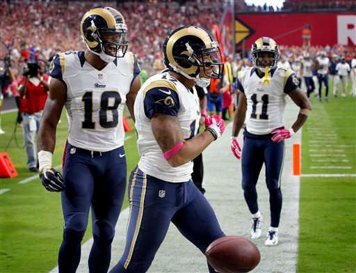 In this Oct. 4, 2015, file photo, St. Louis Rams wide receiver Stedman Bailey (12) celebrates his touchdown reception with teammates Kenny Britt (18) and Tavon Austin (11) during the second half of an NFL football game against the Arizona Cardinals in Gle