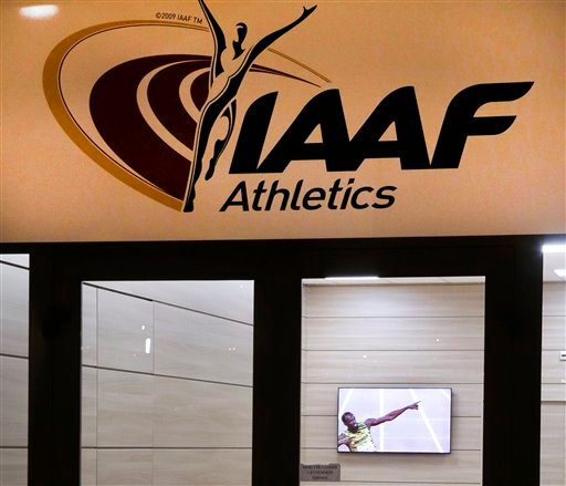 Jamaican athlete Usain Bolt appears on a television screen inside a building belonging to the IAAF (International Amateur Athletic Federation) in Monaco, Friday, Nov 13, 2015. IAAF leaders are set to suspend the Russian federation, keeping the country's t