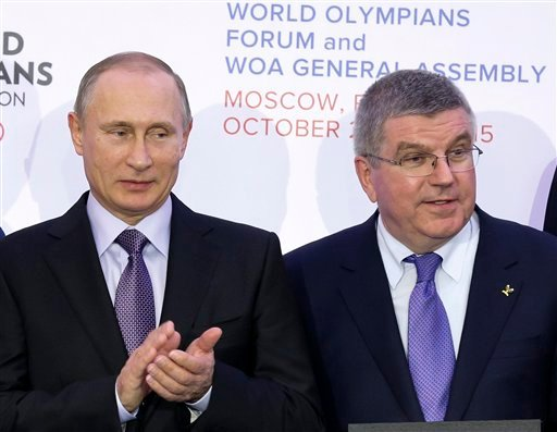 In this Wednesday, Oct. 21, 2015 file photo Russian President Vladimir Putin, left, and International Olympic Committee (IOC) President Thomas Bach attend the World Olympians Forum in Moscow, Russia. Bach met with Russian Olympic Committee head Alexander