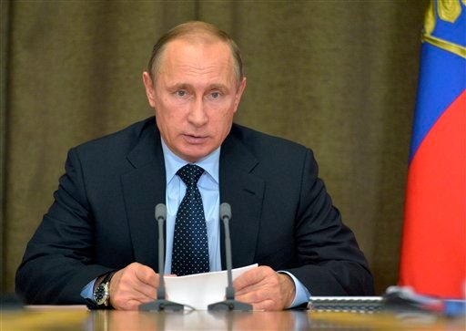 In this Monday, Nov. 9, 2015 file photo Russian President Vladimir Putin heads a meeting on military issues at the Russian Black Sea resort of Sochi, Russia. President Vladimir Putin's spokesman said plans for a new submarine-launched nuclear torpedo show