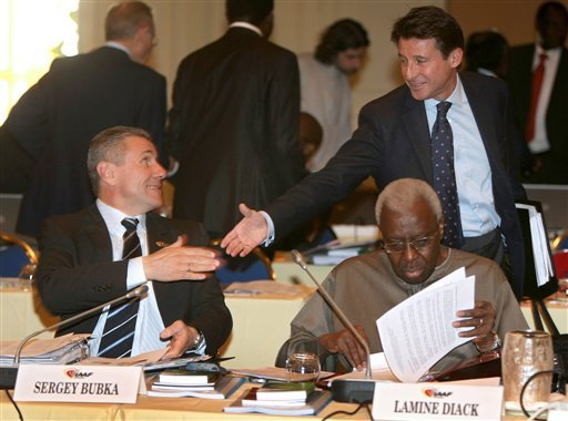 In this Friday, Nov. 20, 2009 file photo, President of the IAAF (International Association of Athletics Federations) Lamine Diak, front right, checks documents as senior IAAF vice president Sergei Bubka, left, and vice-president of the IAAF Sebastian Coe,