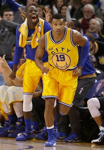 Golden State Warriors forward Draymond Green, left, yells after guard Leandro Barbosa (19) scored against the Los Angeles Lakers during the first half of an NBA basketball game in Oakland, Calif., Tuesday, Nov. 24, 2015. (AP Photo/Jeff Chiu)