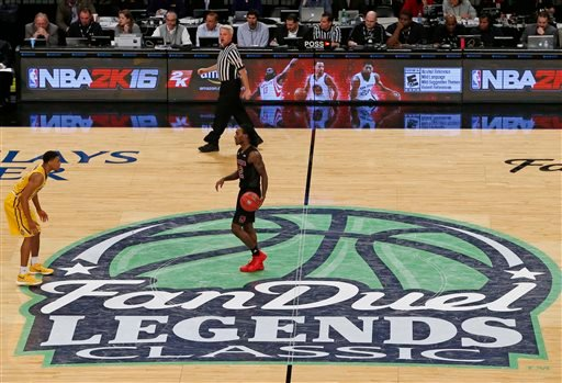 North Carolina State guard Anthony Barber (12) dribbles the ball across the FanDuel logo during the first half of an NCAA college basketball game in the Legends Classic, Tuesday, Nov. 24, 2015, in New York. FanDuel, which sponsored the Legends Classic, an