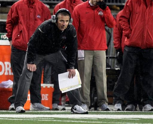 Ohio State head coach Urban Meyer watches from the sidelines against during the second quarter of an NCAA college football game against Ohio State, Saturday, Nov. 21, 2015, in Columbus, Ohio. Michigan State won 17-14. (AP Photo/Jay LaPrete)