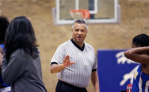 In this Thursday, Nov. 12, 2015, photo, Jay Rodriguez, a referee with the North Texas Basketball Officials Association, makes a point during a high school freshman girls basketball game in Allen, Texas. Violence against referees is as old as sport itself,