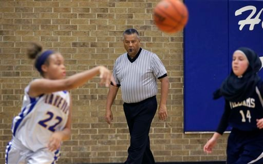In this Thursday, Nov. 12, 2015, photo, Jay Rodriguez, a referee with the North Texas Basketball Officials Association, watches play during a high school freshman girls basketball game in Allen, Texas. Violence against referees is as old as sport itself,