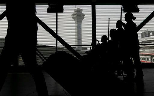 Travelers walk to a ticketing desk at O'Hare International Airport, Wednesday, Nov. 25, 2015, in Chicago. An estimated 46.9 million Americans are expected to take a car, plane, bus or train at least 50 miles from home over the long holiday weekend, accord