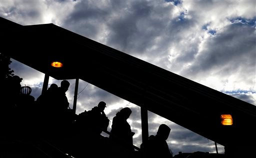 Passengers walk down a stairway to board an Amtrak train heading for New Orleans ahead of the Thanksgiving holiday, Wednesday, Nov. 25, 2015, in Atlanta. An estimated 46.9 million Americans are expected to take a car, plane, bus or train at least 50 miles