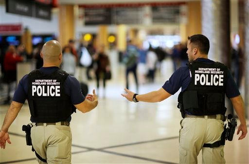 Department of Homeland Security police officers walk through Hartsfield–Jackson Atlanta International Airport ahead of the Thanksgiving holiday Wednesday, Nov. 25, 2015, in Atlanta. The big Thanksgiving getaway went into full swing Wednesday with drivers