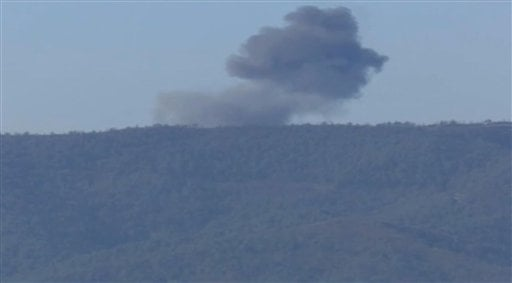 This frame grab from video by Haberturk TV, shows smoke from a Russian warplane after crashing on a hill as seen from Hatay province, Turkey, Tuesday, Nov. 24, 2015. Turkey shot down the Russian warplane Tuesday, claiming it had violated Turkish airspace