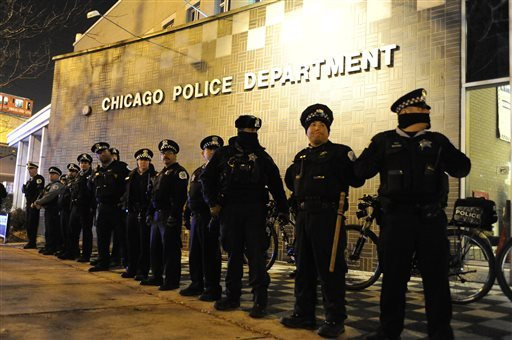 Chicago police officers line up outside the District 1 central headquarters at 17th and State streets, Tuesday, Nov. 24, 2015, in Chicago, during a protest for 17-year-old Laquan McDonald, who was fatally shot and killed in October 2014. Chicago police Of
